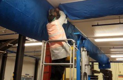 Engineer Installing Air Sock at a Customer Site