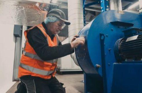 Engineer Examining LEV System on Customer Site