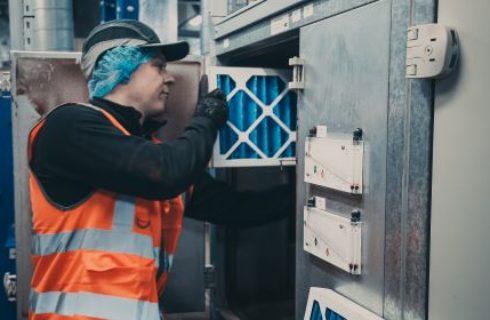 Engineer changing AHU airfilters