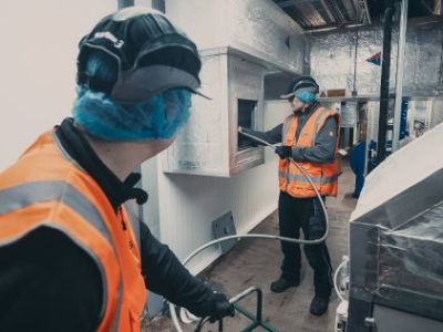 Engineers cleaning ductwork to TR19 standards