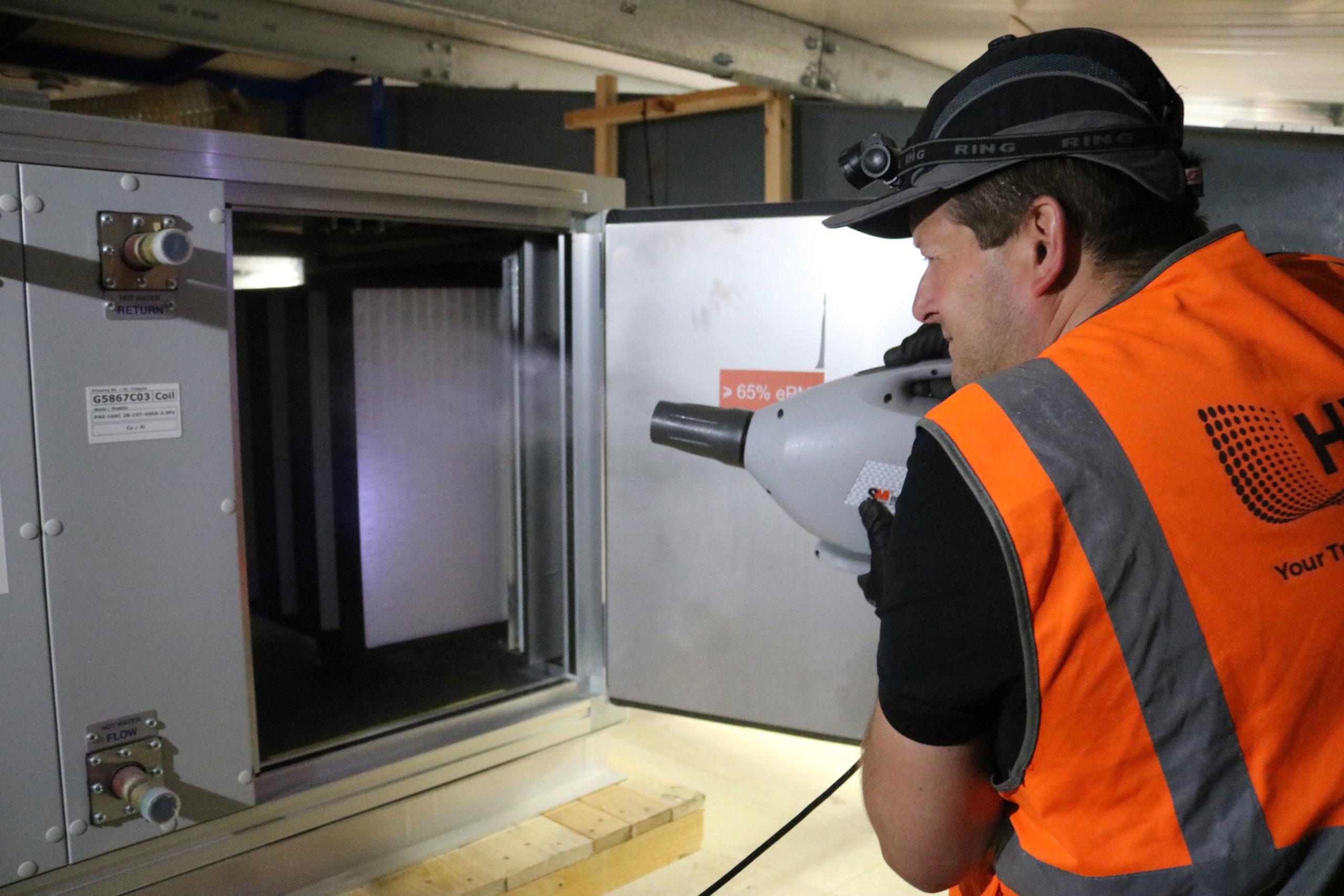 Engineer fogging air filter in AHU